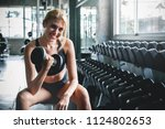 woman workout by lifting... | Shutterstock . vector #1124802653