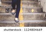 close up woman 's legs walking... | Shutterstock . vector #1124804669