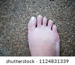 feet stand on stone floor | Shutterstock . vector #1124831339