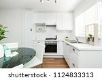 simple home kitchen in modern... | Shutterstock . vector #1124833313