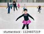 little girl learning to ice... | Shutterstock . vector #1124837219