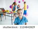 a boy with balloon plays on... | Shutterstock . vector #1124842829