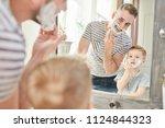 warm toned portrait of handsome ... | Shutterstock . vector #1124844323