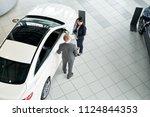 saleswoman and customer... | Shutterstock . vector #1124844353