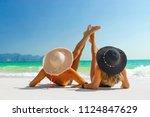 two women sunbathing lying down ...   Shutterstock . vector #1124847629