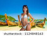 woman relaxing on the tropical... | Shutterstock . vector #1124848163