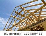 new wooden ecological house... | Shutterstock . vector #1124859488