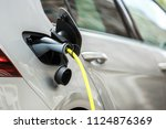 new electric car charging...   Shutterstock . vector #1124876369
