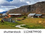 small wooden houses in mountain ... | Shutterstock . vector #1124879930