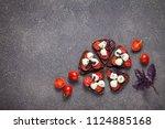 bruschetta with mozzarella and... | Shutterstock . vector #1124885168