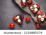 bruschetta with mozzarella and... | Shutterstock . vector #1124885174