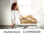 pregnant woman at window... | Shutterstock . vector #1124900330
