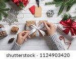 Woman Wrapping Christmas Gift...