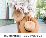 stylish woman's outfit. nature... | Shutterstock . vector #1124907923
