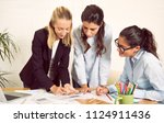 female architects working on... | Shutterstock . vector #1124911436