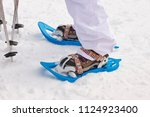 snow rackets and boots... | Shutterstock . vector #1124923400