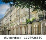row of upmarket terraced houses ... | Shutterstock . vector #1124926550