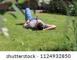 young male lying in the grass... | Shutterstock . vector #1124932850