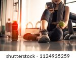 close up of woman using smart...   Shutterstock . vector #1124935259