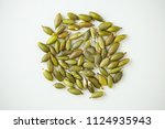 pumpkin seeds on white... | Shutterstock . vector #1124935943