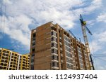 two tower cranes working on... | Shutterstock . vector #1124937404