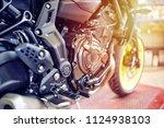 motorbike repair shop | Shutterstock . vector #1124938103
