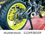 motorbike repair shop | Shutterstock . vector #1124938109