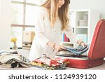 woman preparing summer luggage | Shutterstock . vector #1124939120