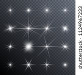 sparkles. glowing light effects.... | Shutterstock .eps vector #1124967233