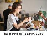 waitress handing order of food... | Shutterstock . vector #1124971853