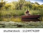 fishing in river during sunrise ... | Shutterstock . vector #1124974289