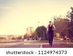 running man runner jogging for... | Shutterstock . vector #1124974373