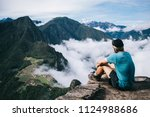 experienced young man tourist... | Shutterstock . vector #1124988686