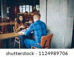 back view of male employee...   Shutterstock . vector #1124989706