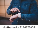 cropped image on man checking...   Shutterstock . vector #1124991653