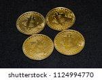 bitcoin on dark background  | Shutterstock . vector #1124994770