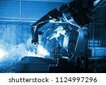 welding robot  in the... | Shutterstock . vector #1124997296