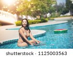 women wear bikinis for swimming ... | Shutterstock . vector #1125003563