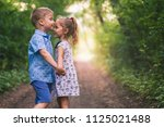 happy kids  girl and boy are...   Shutterstock . vector #1125021488