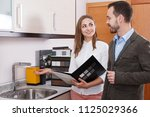 young woman seller consulting... | Shutterstock . vector #1125029366