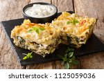 delicious lasagna with chicken... | Shutterstock . vector #1125059036