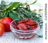 sun dried tomatoes and aromatic ... | Shutterstock . vector #1125059066
