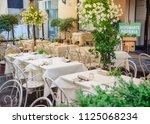 romantic italian street cafe ... | Shutterstock . vector #1125068234