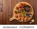 mix bruschetta with sardines... | Shutterstock . vector #1125068414
