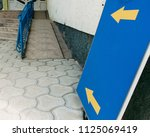 yellow arrows on the blue... | Shutterstock . vector #1125069419