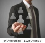 hand touch a virtual icon of... | Shutterstock . vector #1125095513