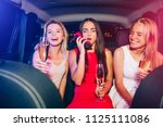 drunk girls are sitting in car... | Shutterstock . vector #1125111086