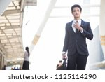businessman walking and holding ...   Shutterstock . vector #1125114290