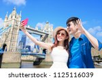 couple selfie happily and... | Shutterstock . vector #1125116039
