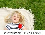 little cute blond girl lying on ...   Shutterstock . vector #1125117098